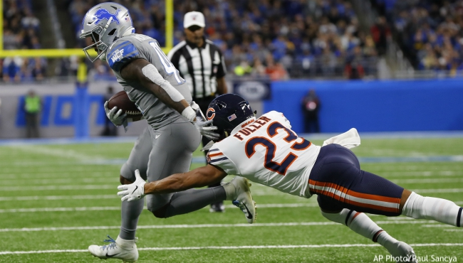 Detroit Lions running back J.D. McKissic is chased by Chicago Bears cornerback Kyle Fuller (23) during the second half of an NFL football game, Thursday, Nov. 28, 2019, in Detroit. (AP Photo/Paul Sancya)
