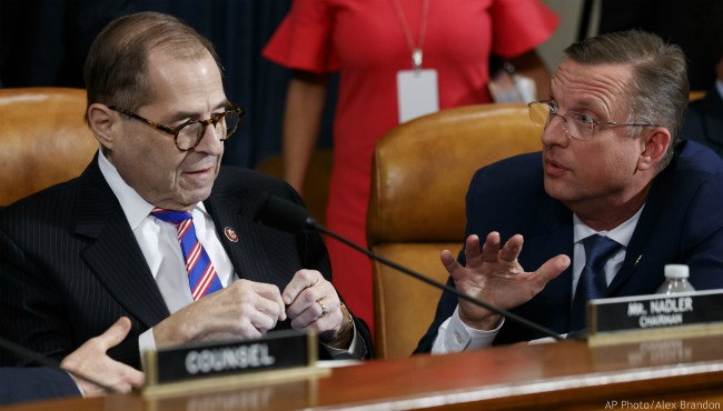 House Judiciary Committee Chairman Rep. Jerrold Nadler, D-N.Y., left, listens to ranking member Rep. Doug Collins, R-Ga., after the House Judiciary Committee hearing on the constitutional grounds for the impeachment of President Donald Trump, on Capitol Hill in Washington, Wednesday, Dec. 4, 2019 (AP Photo/Alex Brandon)