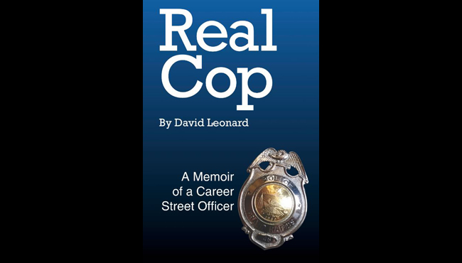 """A photo of the """"Real Cop"""" book cover, which was published by retired Grand Rapids Police Department Officer David Leonard."""