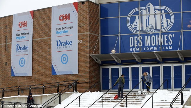 Workers clear snow outside a venue at Drake University, Monday, Jan. 13, 2020, in Des Moines, Iowa, in advance of a Democratic presidential primary debate that is scheduled for Tuesday. (AP Photo/Patrick Semansky)