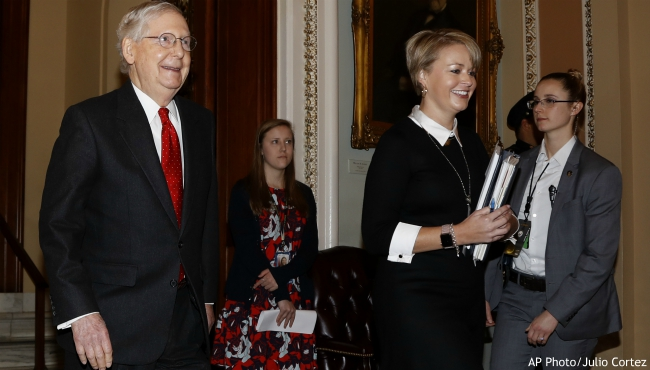 Senate Majority Leader Mitch McConnell, R-Ky., leaves the Senate at the Capitol in Washington, Tuesday, Jan. 21, 2020. President Donald Trump's impeachment trial quickly burst into a partisan fight Tuesday as proceedings began unfolding at the Capitol. (AP Photo/Julio Cortez)