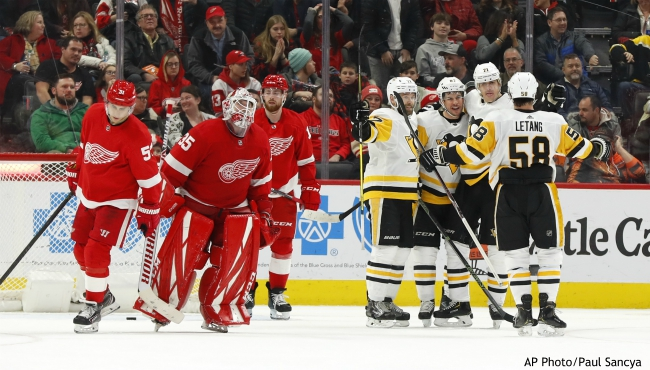 Pittsburgh Penguins center Sidney Crosby, third from right, celebrates his winning goal against the Detroit Red Wings in overtime of an NHL hockey game Friday, Jan. 17, 2020, in Detroit. (AP Photo/Paul Sancya)