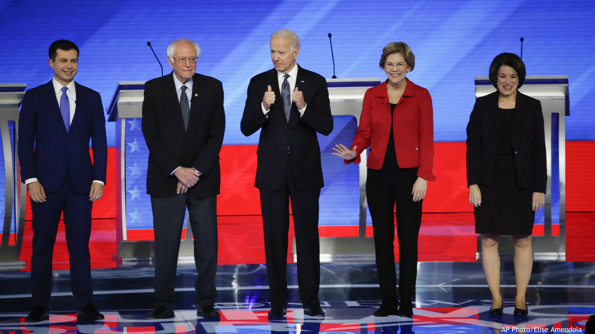 From left, Democratic presidential candidates former South Bend Mayor Pete Buttigieg, Sen. Bernie Sanders, I-Vt., former Vice President Joe Biden, Sen. Elizabeth Warren, D-Mass., and Sen. Amy Klobuchar, D-Minn., stand on stage Friday, Feb. 7, 2020, before the start of a Democratic presidential primary debate hosted by ABC News, Apple News, and WMUR-TV at Saint Anselm College in Manchester, N.H. (AP Photo/Elise Amendola)