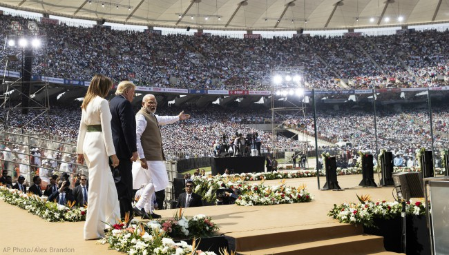 "U.S. President Donald Trump, first lady Melania Trump, and Indian Prime Minister Narendra Modi arrive for a ""Namaste Trump,"" event at Sardar Patel Stadium, Monday, Feb. 24, 2020, in Ahmedabad, India. (AP Photo/Alex Brandon)"