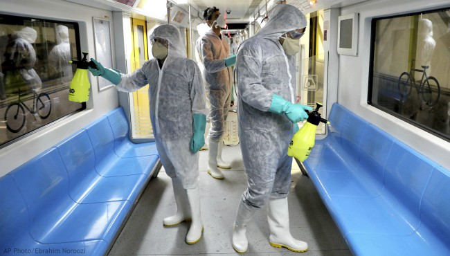 Workers disinfect subway trains against coronavirus in Tehran, Iran, in the early morning of Wednesday, Feb. 26, 2020. (AP Photo/Ebrahim Noroozi)