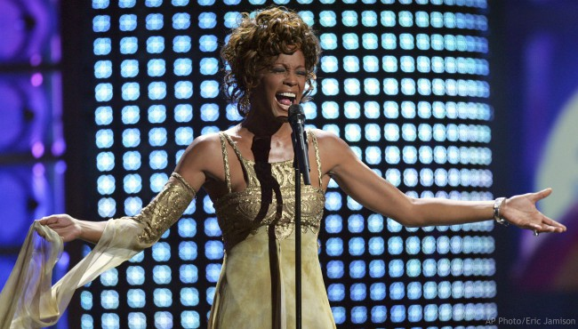 In this Sept. 15, 2004 file photo, recording artist Whitney Houston performs at the 2004 World Music Awards at the Thomas and Mack Arena in Las Vegas. (AP Photo/Eric Jamison, file)