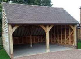 An Oak framed garage in need of garage doors
