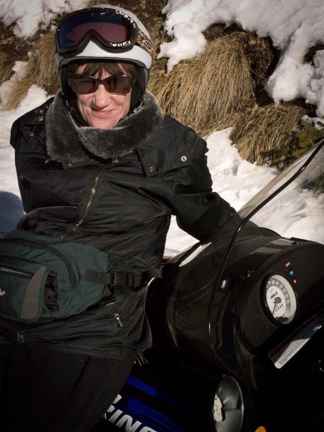 Maria does a snowmobile