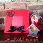 This set includes two beautiful decorative mini birdhouses with heart shaped openings and one red picture frame with a black rose stamped on the upper left-hand corner and a black bow attached on the bottom center. : 1. Red birdhouse with decoupage image on the rooftop 2. Black birdhouse with red rooftop and rose stamped on each side