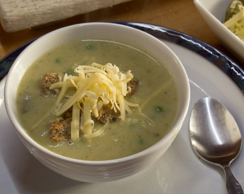 Soup with croutons and grated cheese