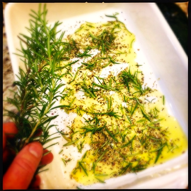 Pan with oil and herbs for grilling