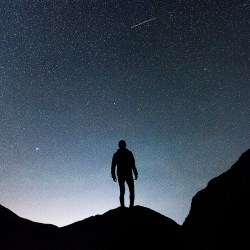 A Sky Full Of Stars. With silhouette of a person. Original public domain image from Wikimedia Commons