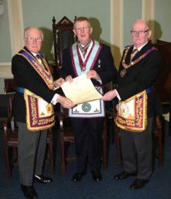 MWBro Benjamin Addy PProGM together with RWBro Alex McLaren PGM present the 150th Certificate to Bro Raymond Christian WM