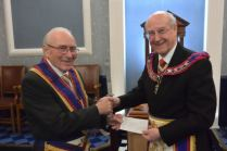 W.Bro Donal Crawshaw presents Chque to APGM Gerald Noel Howard Young PGJD