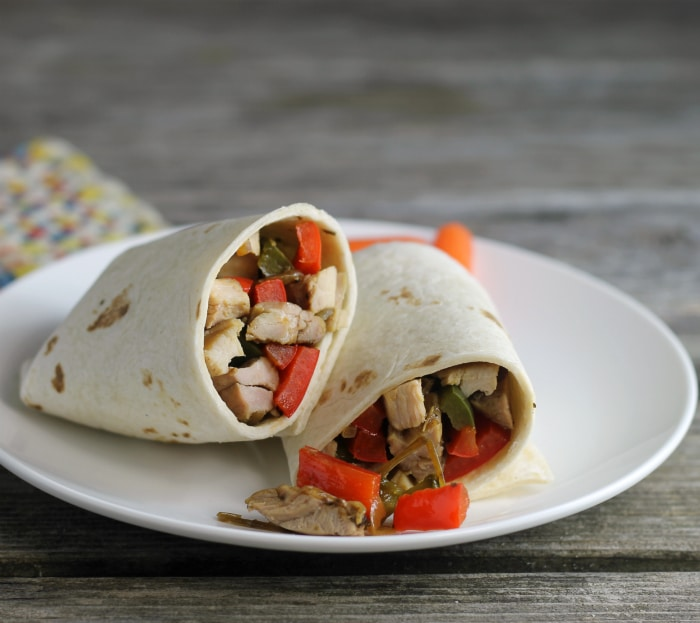 Italian chicken wraps are filled with juicy tender chicken, pepper, onion, and garlic. It is super easy to make and full of flavor.