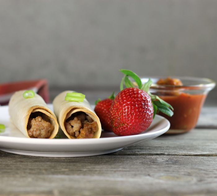 Baked pork taquitos are filled with ground pork and cheese served with salsa, sour cream, or your favorite dip.