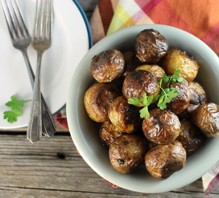 Oven roasted baby potatoes are left whole for roasting. I love the small potatoes, not only are they cute but they are tasty too.