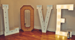 Large LOVE wooden letters being prepared for hire