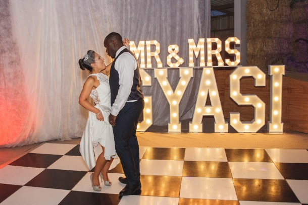 Mr & Mrs GYASI wedding marquee letters lighting up the bride and groom's first dance