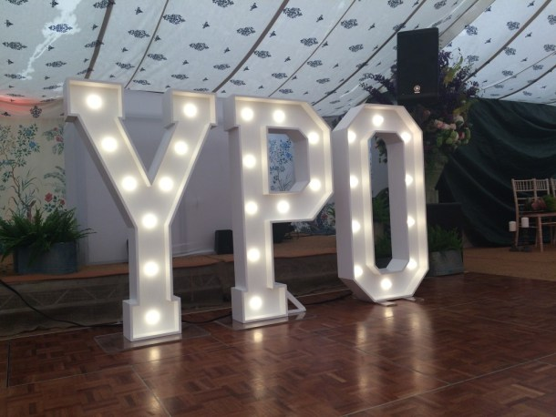 YPO marquee lights in floral marquee