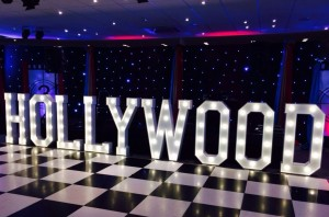 HOLLYWOOD marquee letters lighting up the dance floor at a party