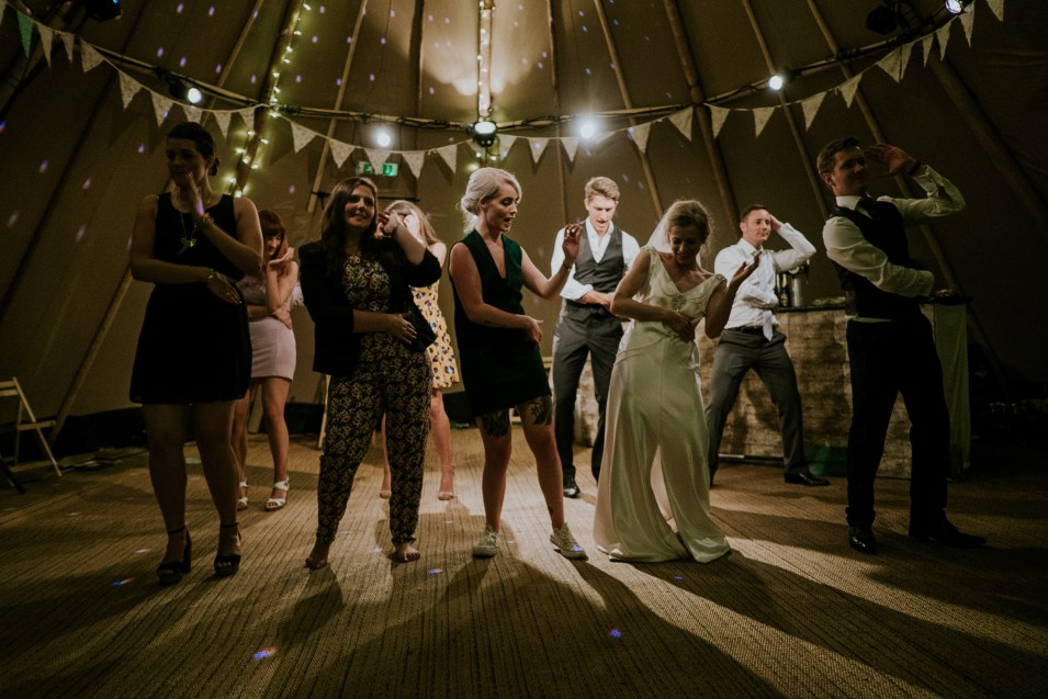 People dancing in a tipi tent