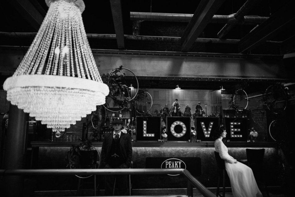 Bride and groom with boxed LOVE light up letters at The Peaky Blinders Bar, Liverpool