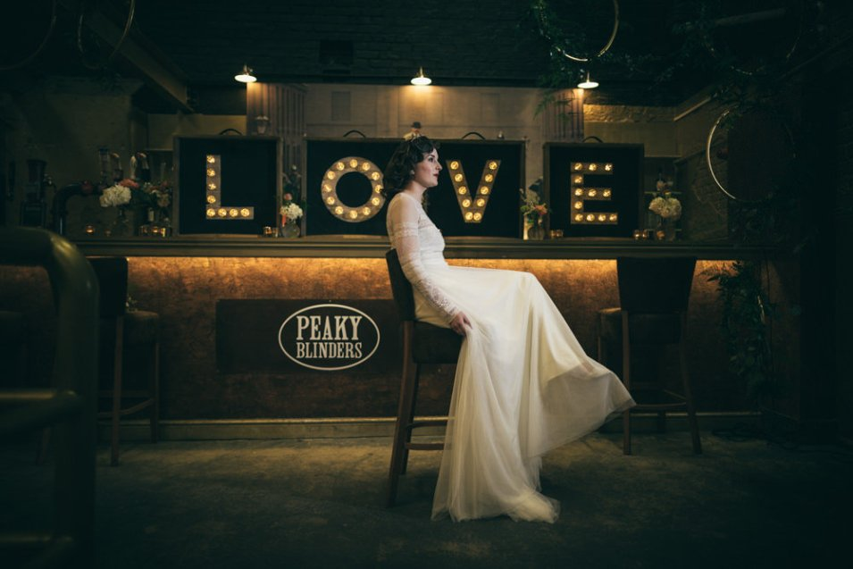 Bride sat down with boxed LOVE light up love letters in background
