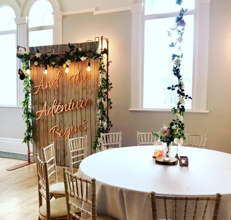 Rustic Wedding Backdrop with beautiful artificial foliage and hanging Edison bulbs