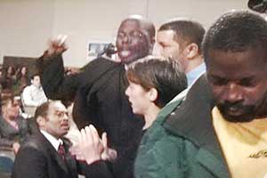 Pastor Torin Sanders protests at City Council<br>meeting in New Orleans.
