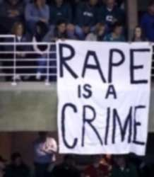 Students protest during 'Midnight<br>Madness' at MSU's Breslin Center.