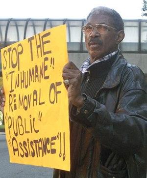 Tashi Kiya protests Michigan welfare cuts, Oct. 2011.WW photo: Kris Hamel