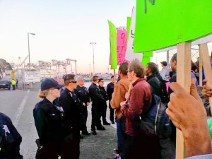 Truckers and community supporters picket the port.