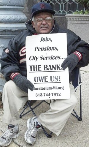 One of many protesters outside federal bankruptcy court, Oct. 28.WW photo: Kris Hamel