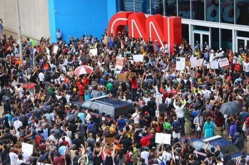 Thousands march on CNN to denounce its Ferguson coverage