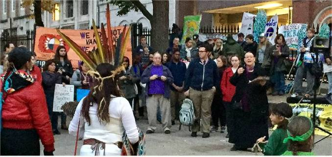 Mahtowin Munro of United American Indians of New England (UAINE) speaking at Boston rally for Standing Rock.