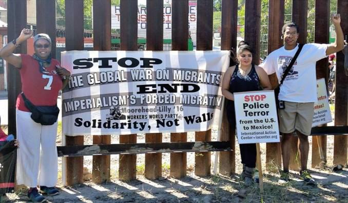 WWP presidential candidate Monica Moorehead, former Mexican political prisoner Nestora Salgado, and Los Angeles WWP leader John Parker at apartheid wall dividing Nogales.