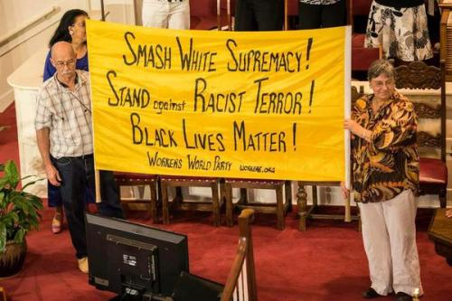 At Big Bethel AME church in Atlanta. The pastor asked for the banner to be held behind the pulpit during the Friday service honoring those killed in Charleston, S.C.Photo:@BigBethelAMEC