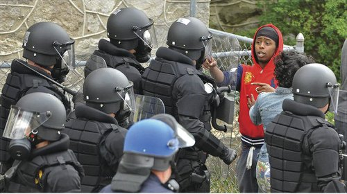 Baltimore youth faces down militarized police.Photo: Richard Reilly