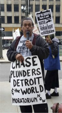 Detroit city retiree Bill Davis speaks out against Chase, May 19.WW photo: Kris Hamel