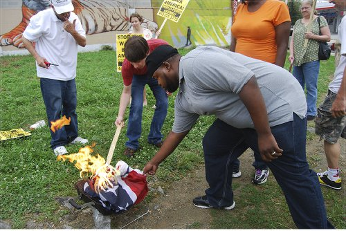 Baltimore Peoples Power Assembly burns Confederate flag on July 4.