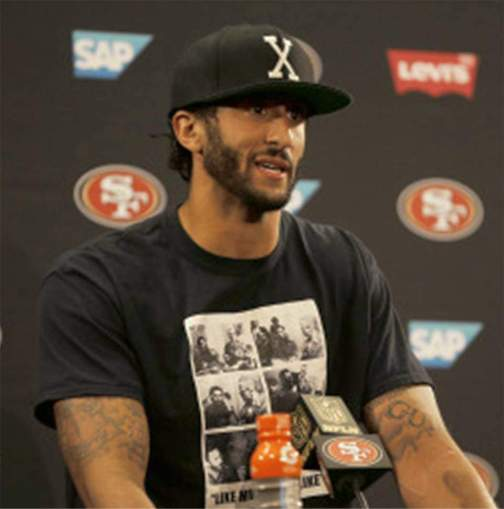 Wearing a shirt showing the 1960 meeting between Fidel Castro, and Malcolm X in Harlem, Colin Kaepernick speaks at press conference on his refusal to stand for the U.S. national anthem, Aug. 26.