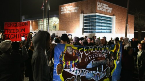 Standing firm against police brutality in Ferguson, Mo., on March 13, less than 24 hours after two cops were allegedly shot,