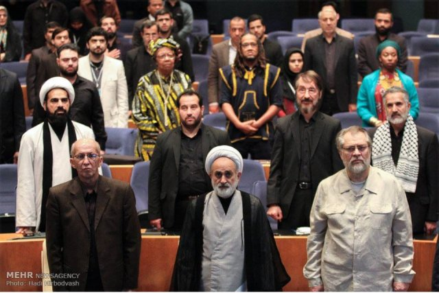 """Audience stands for the Iranian National Anthem and the Black National Anthem """"Lift Every Voice."""""""
