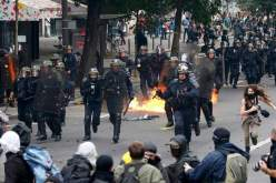 French police attack protesters in Nantes, western France.