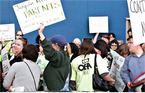 OEA rallies outside board meeting.