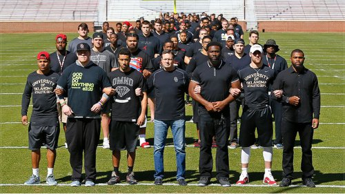 Oklahoma University football team hold protest against SAE racist tape, March 12.