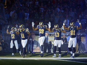 St. Louis Rams pro-football players, know the truth behind the slogan, 'Hands up, don't shoot.' It's what the corporate media wants to stop.