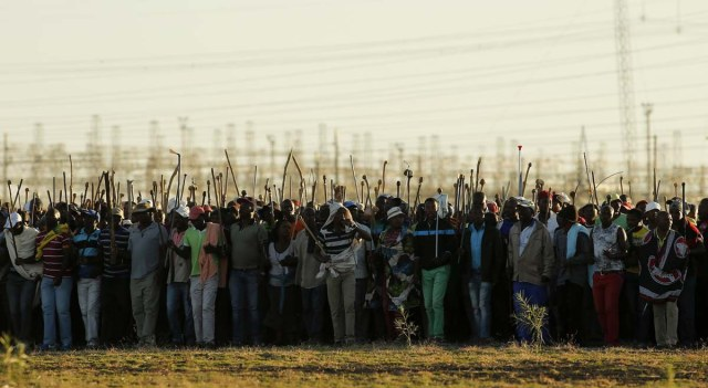 Miners on strike chant slogans as they march in Nkaneng township outside the Lonmin mine in Rustenburg