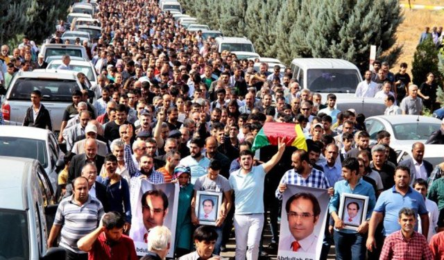 Unions in Diyarbakir, Turkey, hold general strike and march one day after Oct. 11 massacre.